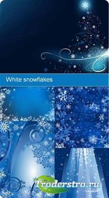Белые снежинки на голубом фоне